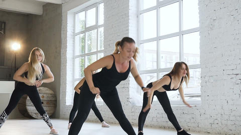 A group of six athletic women a perform fitness training sessions in fitness gym Footage