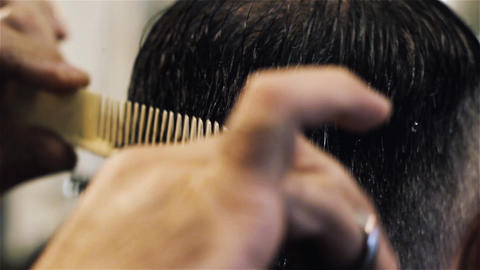 Male Hairdresser Cuts Hair Footage