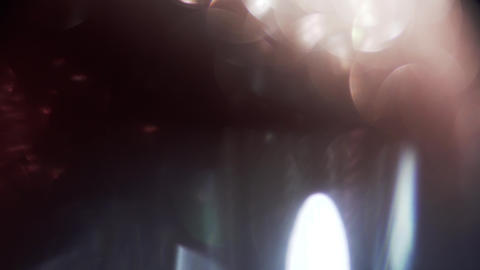 Glamorous soft and organic play of light breaking through a glass crystal Footage