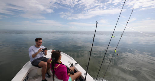 Fishing from boat - people going fishing with fishing rod on open water Live Action