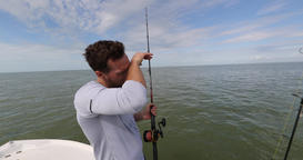 Fishing - tired exhausted proud sport fishing man after shark fishing fight Footage