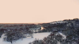snow falling. winter wonderland. snowing snowy. sunset dusk sunshine. forest Footage