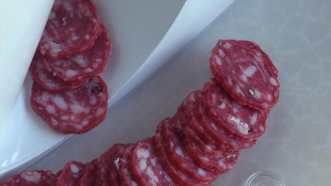 European Sausage Cut by Machine On Tray GIF