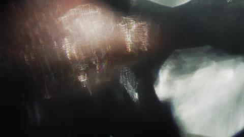 Dreamy particles of velvet tones floating in the dark room Footage