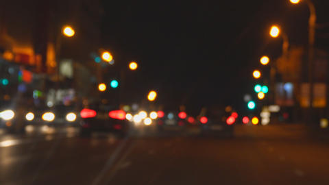 Blurry view of night streets and lights at night Footage