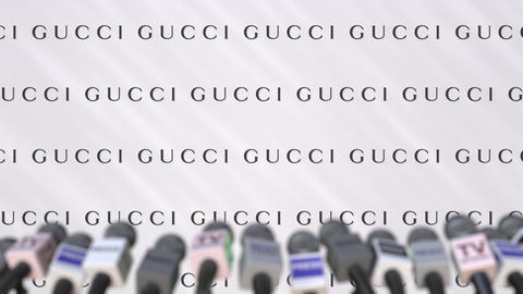 Press conference of GUCCI, press wall with logo and microphones, conceptual Footage
