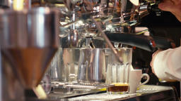 Barista is Making Coffee with Milk using Steaming Machine in the Cafe or Shop Archivo