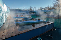 People enjoying bathing relax in spa pool with thermal mineral water Fotografía