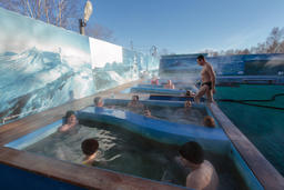 People enjoying bathing relax in spa pool with natural thermal mineral water Fotografía
