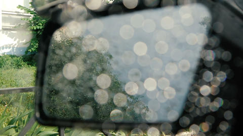 The side window of the car is lowered with rain stones on it - slow motion Footage