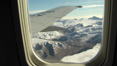 The Andes Mountains Seen From The Window Of An Airplane GIF