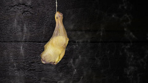 Chicken Thigh Hanging On The Rope Against Rustic Wooden Background Animation
