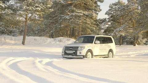 White SUV on snowy off road GIF