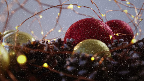 Video composition with falling snow over baubles in nest Animation
