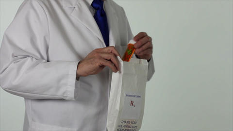 pharmacist putting drugs in bag Live Action
