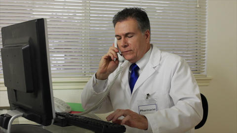 pharmacist answers phone Footage