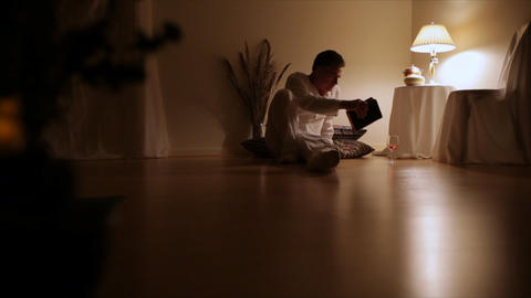 man walks in reads book Footage