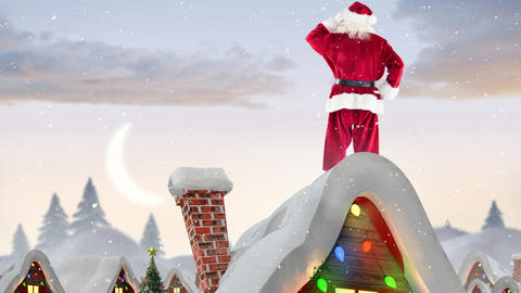 Santa clause on a roof of a decorated house in winter scenery combined with falling snow Live Action