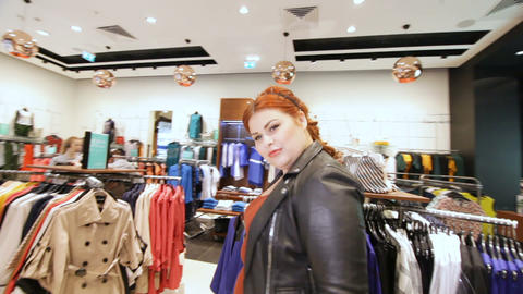 plus-sized woman chooses cocktail stylish handbag in store GIF