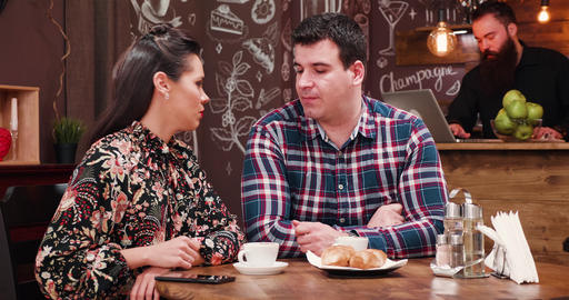 Couple on a date in stylish coffee shop pub restaurant drinking coffee and Footage