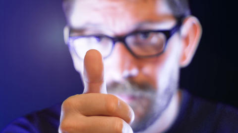 man with a blurred face makes a thumb up, positive, footage represents feelings GIF