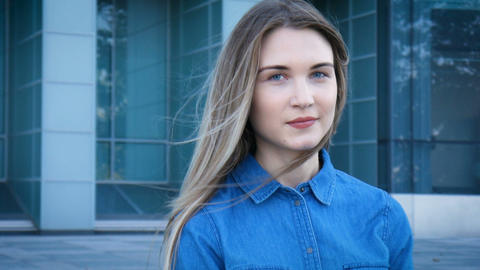 Pretty girl with beautiful blue eyes and long hair, 180 parallax tracking shot Footage