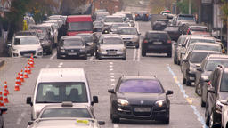 Front shot of vehicles slowly riding in traffic jam on city road Footage