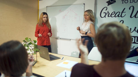 Businesspeople meeting brainstorming team. Two girls presenting successful Footage