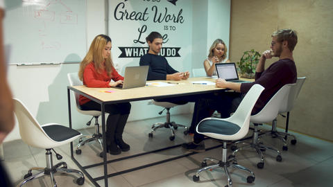 A colleague joins the team of entrepreneurs to discuss a strategy in new startup Footage
