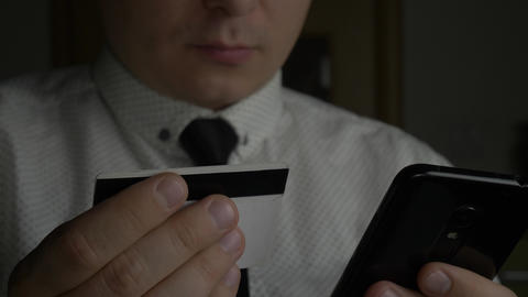 Manager or businessman holding credit card and using smartphone 영상물
