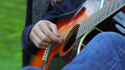 Romantic guitarist is playing outdoors Stock Video Footage