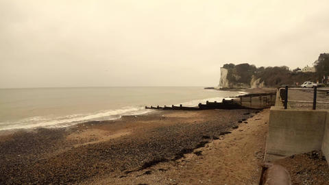 Some seagulls fly over the sea in Dover cloudy day Footage