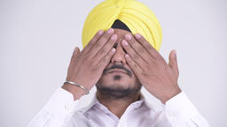 Bearded Indian Sikh businessman showing see no evil concept Footage