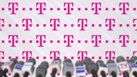 Media event of T TELEKOM, press wall with logo and microphones, editorial Footage
