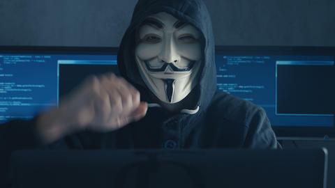Cherkassy, Ukraine, January 10 2019: Anonymous Hacker in Black Hoodie Hiding his 영상물