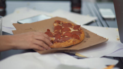 Female hand taking a slice of pizza from the table close up 영상물
