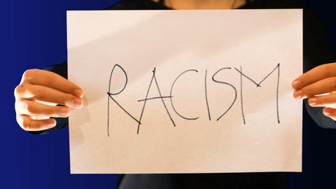 teenage girl holds a paper sign in her hand, with the word racism. Crumple the GIF