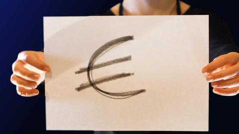 teenage girl holds a paper sign in hand, with the symbol of the euro. Crumple Footage
