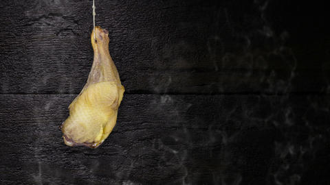 Chicken Thigh Hanging On The Rope Against Rustic Wooden Background Videos animados