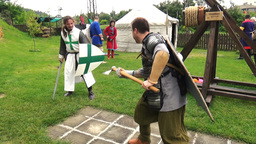 Two medieval knights sword battle axe fighting in reconstruction historical fest Footage