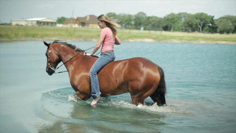 girl and her horse in the pond Footage