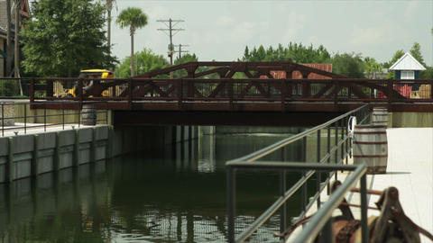 golf cart crosses old bridge Footage