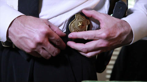 detective putting his badge on Live Action