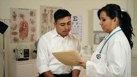 Latino woman doctor talking to paitent Live Action