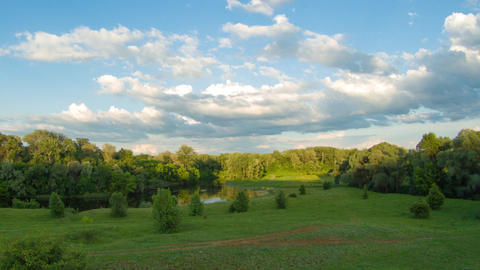 Evening summer nature timelapse with sky clouds and green hills GIF