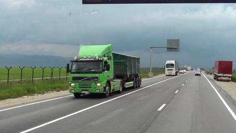 Heavy car traffic seen through the windshield of a truck is in the middle of the Footage