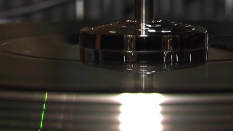 Hands of a DJ turntable that moves and mixes the music during a concert show soc Footage