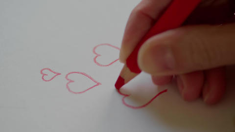 Hand drawing hearts by red pencil for Valentine's day Footage