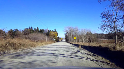 Driving Rural Dirt Road During Day. Driver Point of View POV Countryside Unpaved Live Action