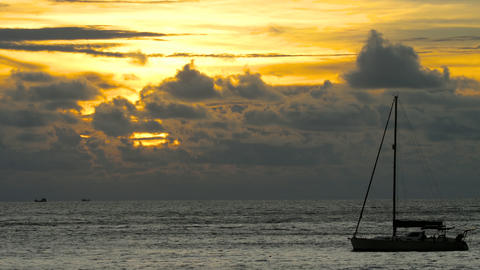 Yacht in the tropical sea at dramatic sunset Footage